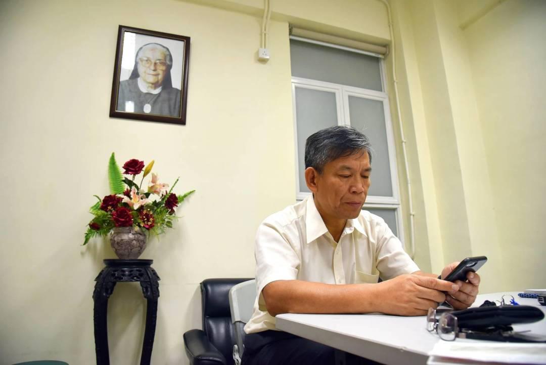 進行訪問的會議室內,掛着高志慈條女的相片。
